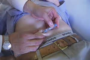 A Doctor Injects A Patient With A Libido Suppressing Drug Abc News Australian Broadcasting