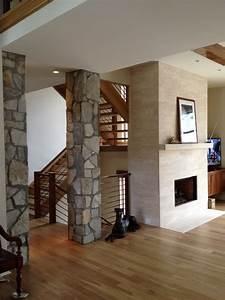 Interior Stone Columns & Travertine Fireplace