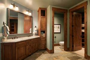 Homes with dark trim bathroom rustic with two sinks dark