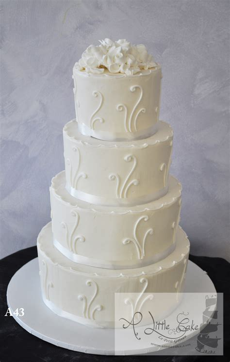 elegant buttercream wedding cake  white bands