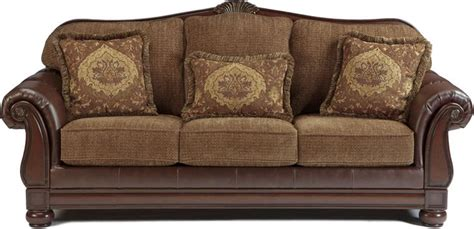Ashley furniture offers a fully integrated product line that takes the guesswork out of furnishing your home. Two Tone Traditional Sofa with Wood Trim Accents   Ashley ...