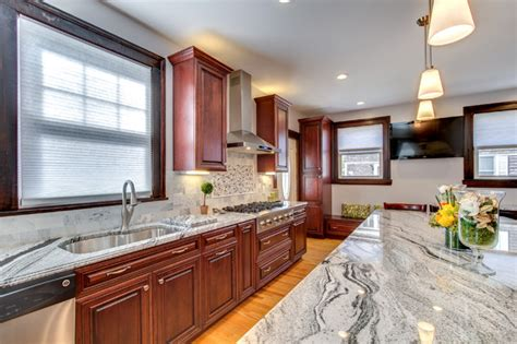 viscont white granite countertops  cherry cabinets