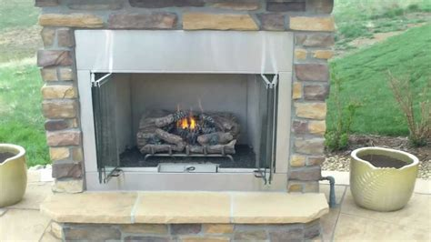 outdoor gas fireplace  buff flagstone patio installed