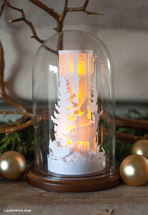 paper cut winter scene   glass dome lia griffith