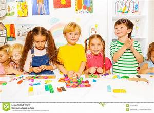 Happy Boys And Girls With Plasticine In Classroom Stock ...