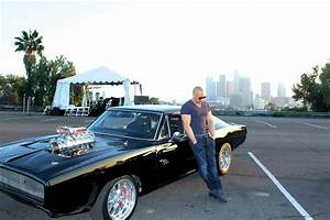 Vin Diesel standing next to 1970 Dodge Charger from Fast ...