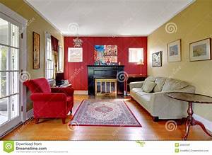 Living Room With Red And Yellow Walls And Fireplace