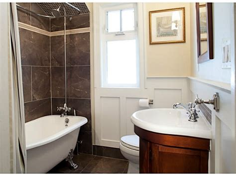 enclosed clawfoot tub shower head main floor bath