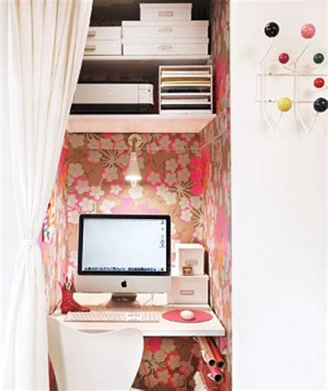 tiny home office ina a small closet with floral wallpaper