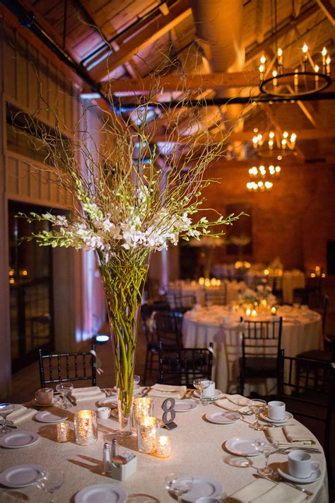 tall orchid  willow branch centerpieces  diy table