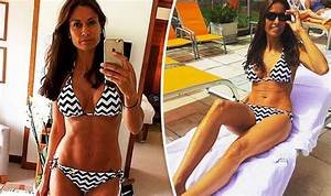 Melanie Sykes, 45, displays washboard abs as she strips ...