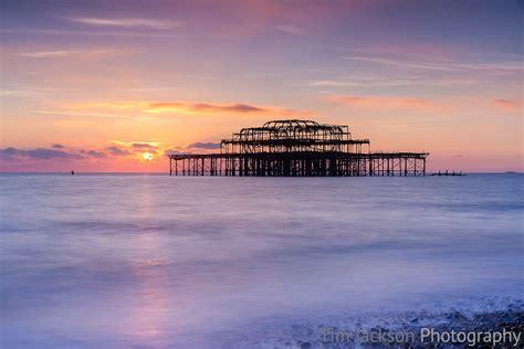 sunset  remains   brighton pier tim jackson