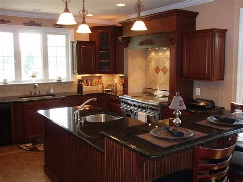 wood kitchen cabinets 16 best images about cabinets with uba tuba granite on 1587