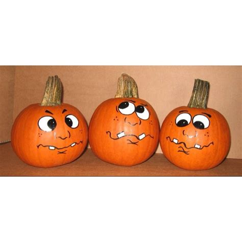 painted pumpkin faces more pumpkin faces hand painted pumpkins pinterest face pumpkin decorating and halloween
