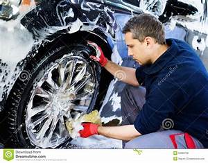 Man Worker On A Car Wash Stock Photo