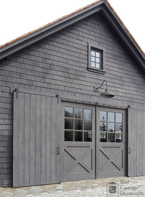 Gray Barn by Garage Doors Garage And Farms On