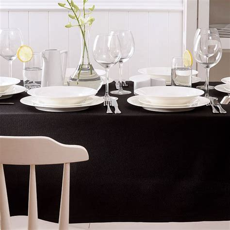 black and white dinner table setting create sophisticated drama with a black tablecloth
