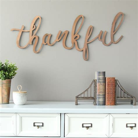 """Whether you're looking to make a tight space feel larger or just want to add a little bit of plus, they play up the vibe that your other decor has established. Stratton Home Decor Bronze """"thankful"""" Script Wall Decor"""