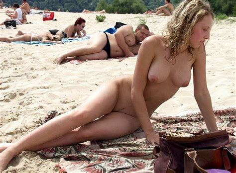 Young Exhibitionists Sunbathing Nude On The Beach Outdoor Sex Content Pics