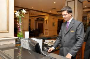 hotel management trainee working at the front desk at the