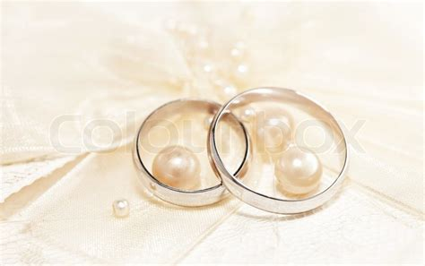 wedding ring pair pair of golden wedding rings invitation card decorated with silk bow pearls stock photo