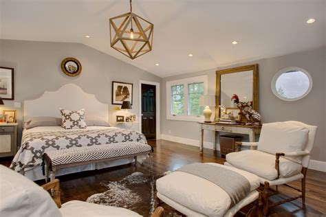 gold accent wall bedroom transitional with sitting area southwestern rugs