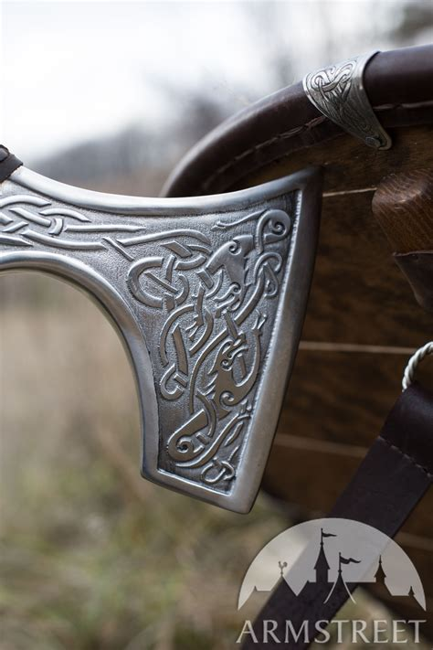 decorative viking axe head  etched wolves