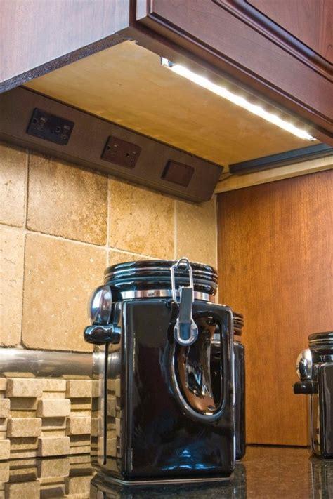 hidden kitchen outlets   cabinet lighting