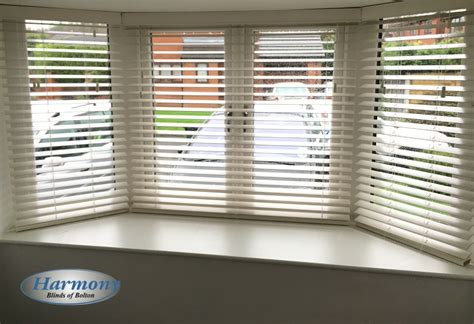 white wooden blinds   bay window harmony blinds