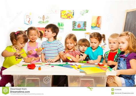 many drawing and gluing stock image image 37536249 331 | many kids drawing gluing large group little painting pencils glue stick art class kindergarten 37536249