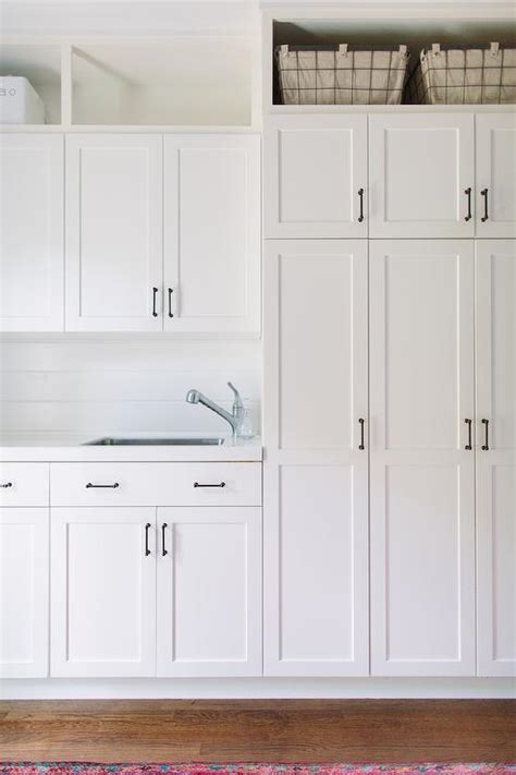 White Laundry Cabinets with Shiplap Backsplash Transitional Laundry Room