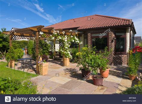 Back Garden Of Bungalow With Pergola And Patio, England
