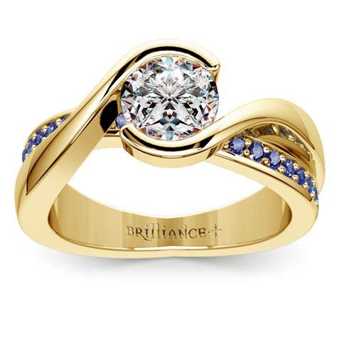 bezel sapphire gemstone bridge engagement ring  yellow gold