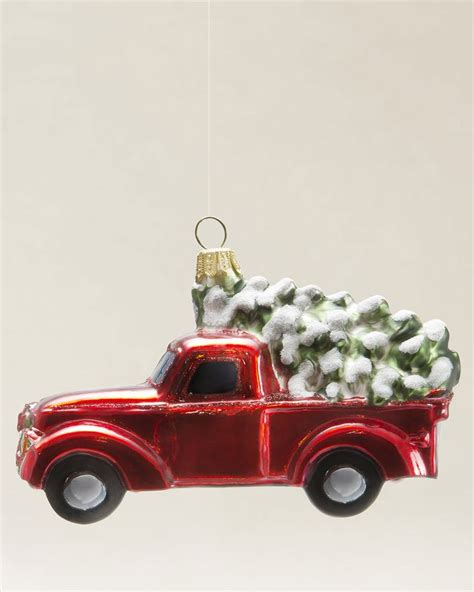 bringing home a christmas tree red pick up truck with