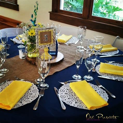 navy  yellow rustic themed wedding table decor event