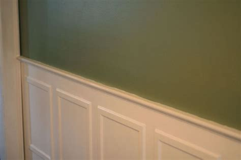 sage green walls  white picture frame moulding