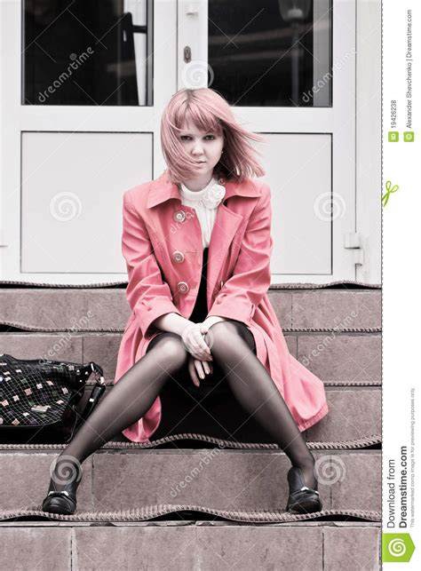 Beautiful Woman Sitting On Stairs Royalty Free Stock