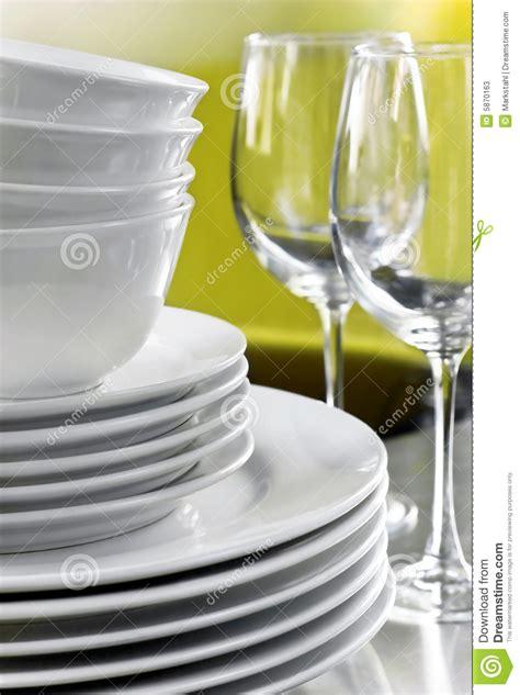 plain white plates bowls  crystal wine glasses stock