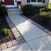 Adding Pavers To Concrete Patio Decorate Adding Pavers Around A Standard Concrete Walkway Can Give Your
