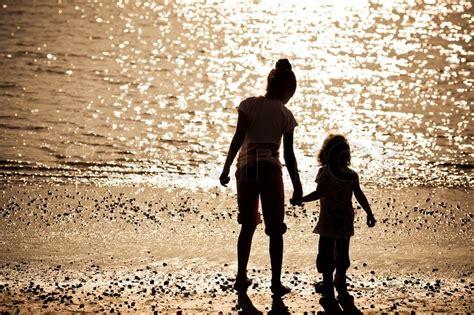 silhouette   children  sea beach stock photo