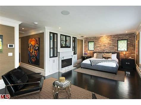 In The Master Bedroom, Brick And Grasscloth Provide Visual