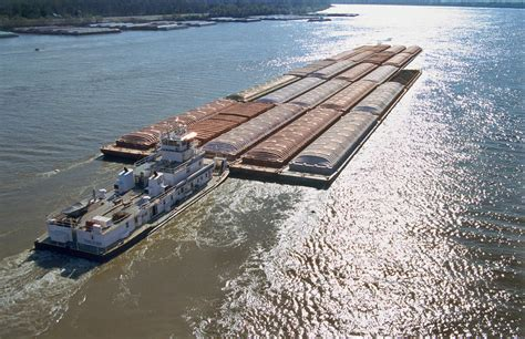 Tow Boat Companies In Vicksburg Ms by Towboats And Barges On The Mississippi Photograph By Garry