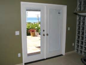 beautiful french doors with blinds inside on door guy