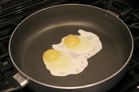 eggs fried cooking yolk breaking egg pan crack cookbook chance risk distance less