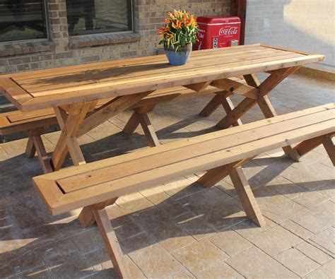 outdoor wooden picnic table with detached benches and