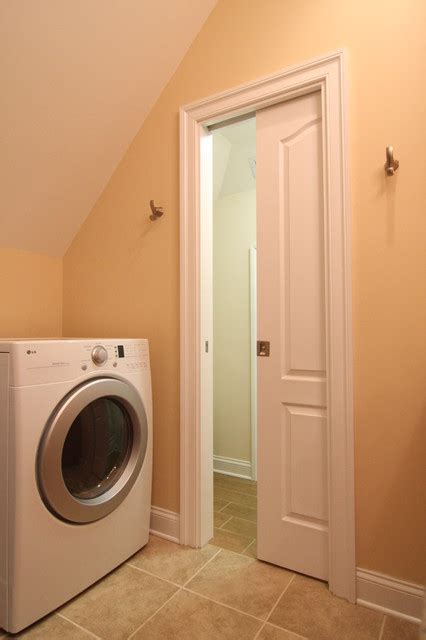 pocket door leads to bathroom conversion traditional laundry room richmond by criner