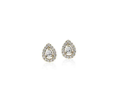 pear shaped diamond halo stud earrings   yellow gold