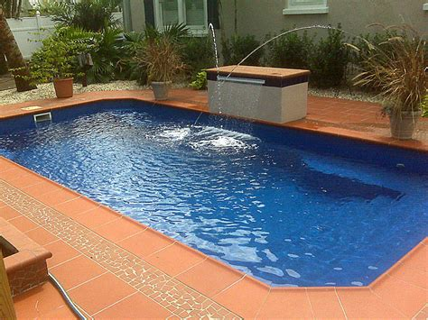gorgeous fiberglass swimming pools with tile deck material