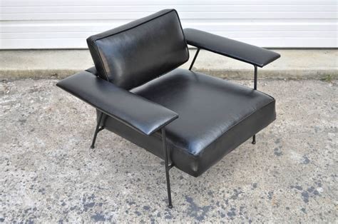 wrought iron and black leather lounge chair with ottoman