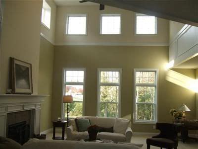 trim work to up walls and define space for the home high ceiling living room